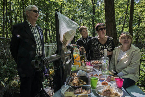Former inhabitants of the city of Chernobyl feast on the graves of their dead according to the Orthodox tradition. Chernobyl city cemetery.