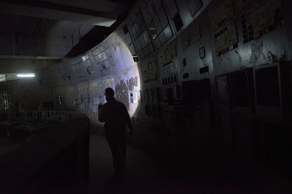 A worker inside the damaged control room of reactor number 4. Here everything began. The control room number four now is buried in a small sarcophagus of concrete and the access is limited to workers only.