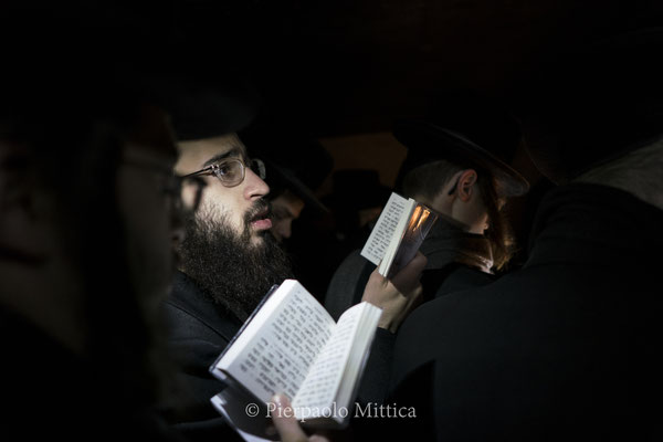 Jews while praying on the tomb of Rabbi Menachem Nochum Twersky.