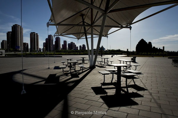 Empty tables in a never opened bar in the new district of Kangbashi, Ordos