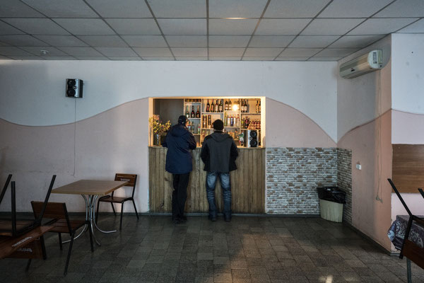 two customers at a bar in Chernobyl town