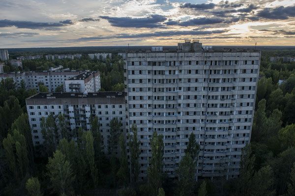 The abandoned city of Pripyat, overrun by nature.