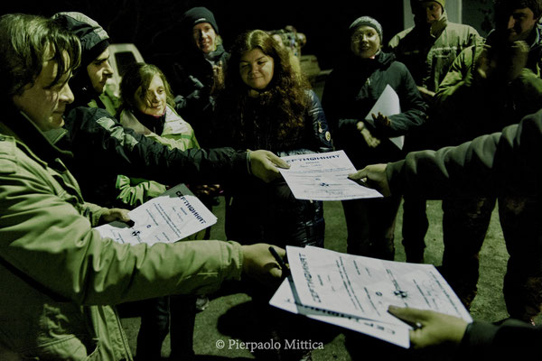 Yuriy Tatarchuck while giving to tourists diplomas certifying their visit to the exclusion zone