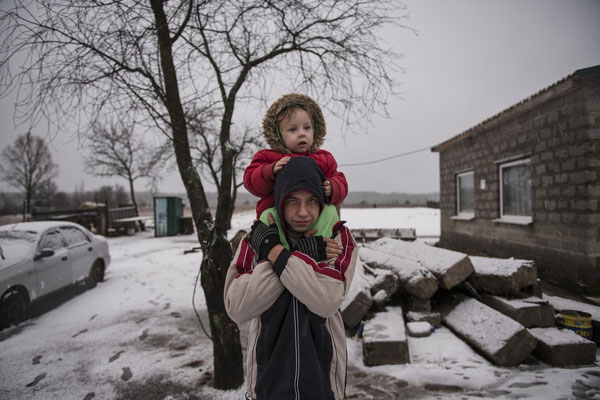 Valeri, 16 years old and her sister Victoria, 3 years old, live in Kovalivka, a contaminated village situated 5 km from the Chernobyl Exclusion Zone.