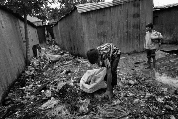 Tokai collecting gagbage, Toghi slum, Dhaka.