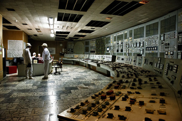 Workers inside control room of reactor number 2. Despite the reactors were shut down in 2000, all staff must continue working until 2065, date of reactors decomissioning, to maintain reactors safety.