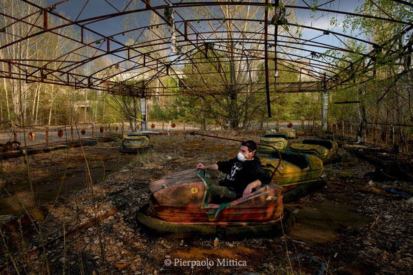Gabriele playing with bumpers cars, Pripyat exclusion zone