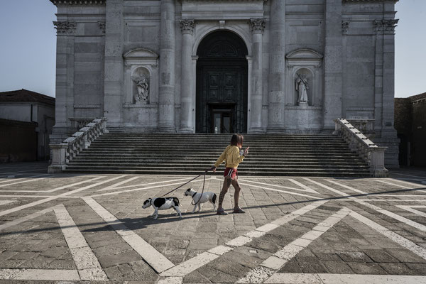 Walking with dogs in the square of the Redentore church, Giudecca