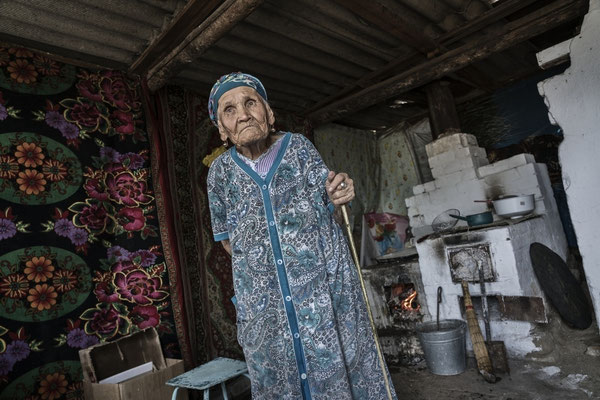 Duisenbaeva Sabira, 82 years old in her house in Bodene village. Duisenbaeva Sabira, has ten children, is one of the direct witnesses of the atomic explosions carried out in the air. She lives in the contaminated village of Bodene