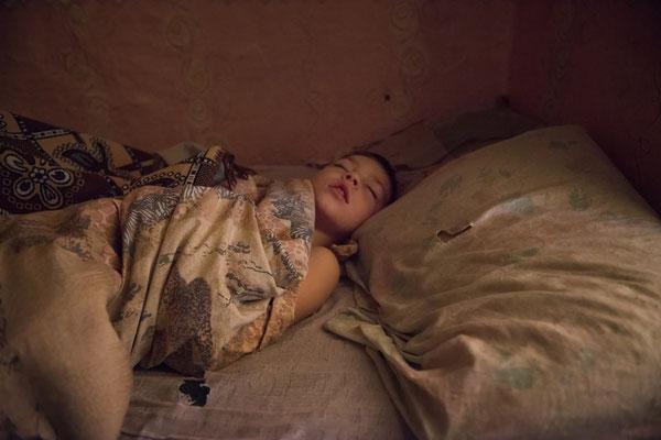 Vladik sleeping at his home in Radinka