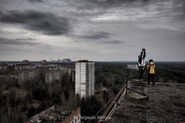 Selfie from the roof of a building in the city of Pripyat with distant views of the nuclear power plant, zone of exclusion