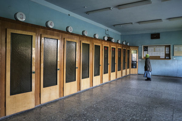 The post office in the town of Chernobyl in the exclusion zone. A line of telephone cabins from the Soviet era, no longer in use also due to the advent of mobile phones