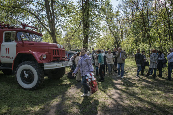 Former inhabitants on their way to the Chernobyl cemetery.