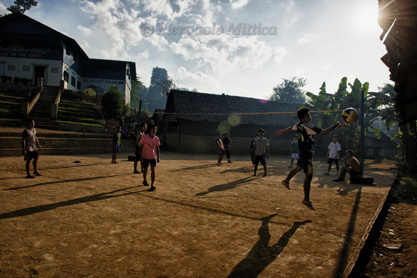 Refugees playing volleyball, Mae La Refugee camp, Thailand