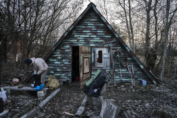 Sasha in front of the foresters cabin while preparing his backpack before heading to Pripyat