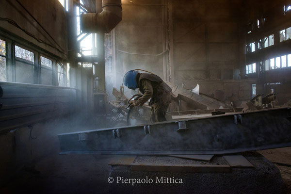 Yuriy while sandblasting the radioactive scrap metal