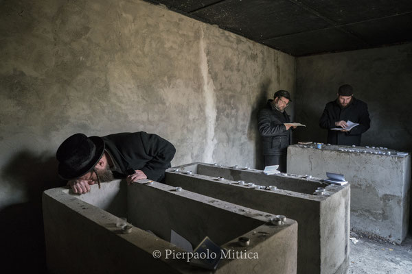 Jews while praying on the tombs of  Grand Rabbi Aharon Twersky Admur of Chernobyl and Grand Rabbi Menachem Nachum Twersky Admur of Chernobyl.