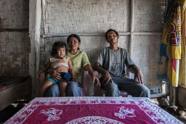 Suparman with his wife and grand daughter at home. They live in Sumberwatu village