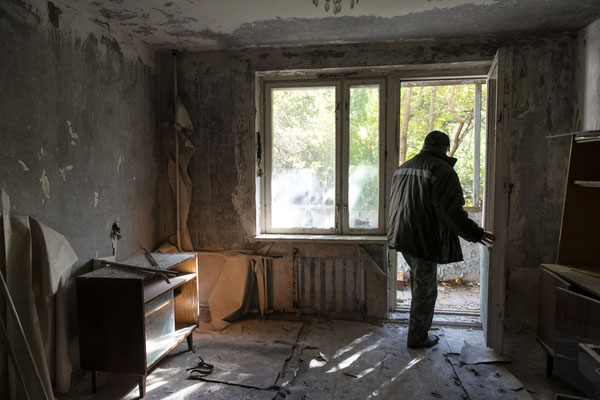 Valeri, a former resident of the city of Pripyat, visiting the apartment where he lived before the accident. City of Pripyat