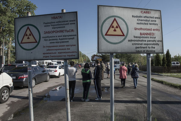 Former inhabitants waiting to enter the Chernobyl exclusion zone.
