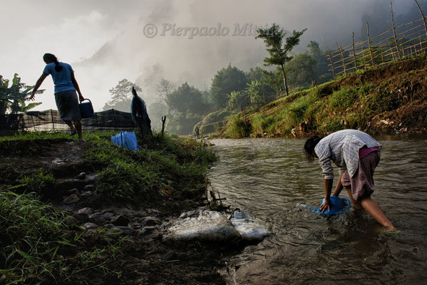 Taking water from the river to irrigate the fields, Mae La refugee camp, Thailand
