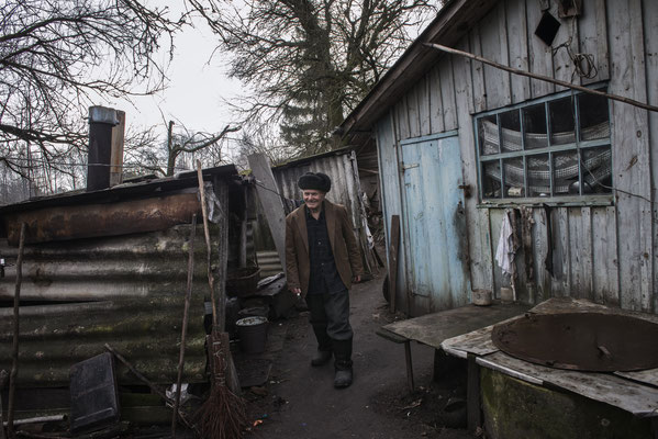 Ivan Ivanovich Semenyuk, 82, in his home, Paryshev, Chernobyl Exclusion Zone