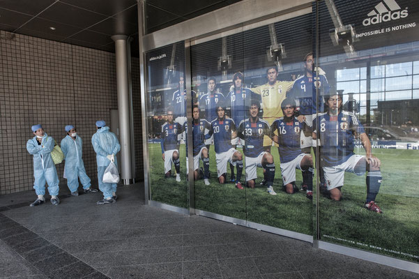 """Workers preparing to go to work, J village, the Tepco headquarter, Fukushima """"No-Go Zone"""", Japan."""