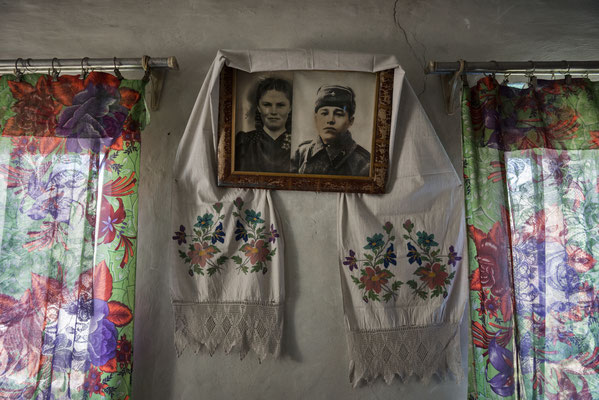 Portrait of Maria Shovkuta and her husband, when they were younger, Opachici village, Chernobyl Exclusion Zone