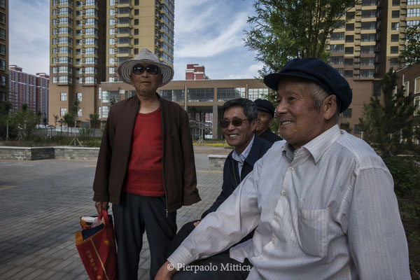 local residents  of the neighborhood used as social housing in the new district of Kangbashi, Ordos