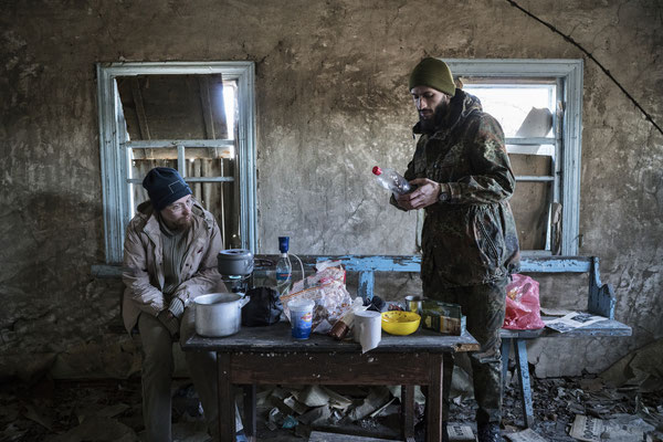 Sasha and Jimmy preparing lunch in the abandoned village of Rudnya Veresnya.