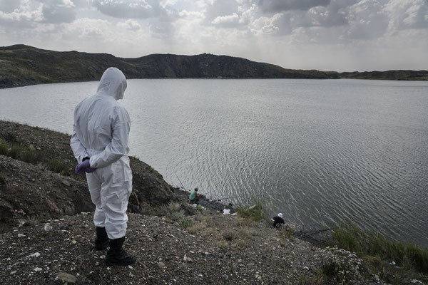 Amir Kayirjanov, a scientist at the Kurchatov nuclear center while observing some fishermen fishing in the atomic lake, one of the most contaminated places on the Semipalatinsk shooting range Many people come to the atomic lake to fish.