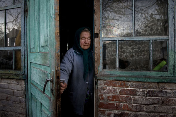 Maria Semenyuk, 78 years old, in her home waiting for her husband Ivan. On May, 17th 2016 Maria has died after living all her life in her home. She was buried in Paryshev cemetery. Paryshev, Chernobyl Exclusion Zone.