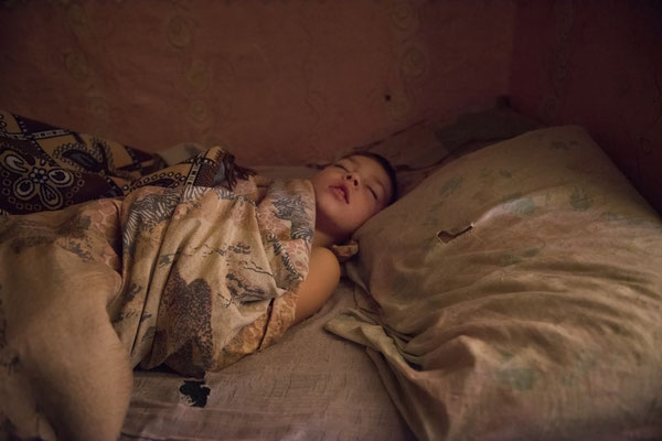 Vladik while sleeping at his home in the contaminated village of Radinka.