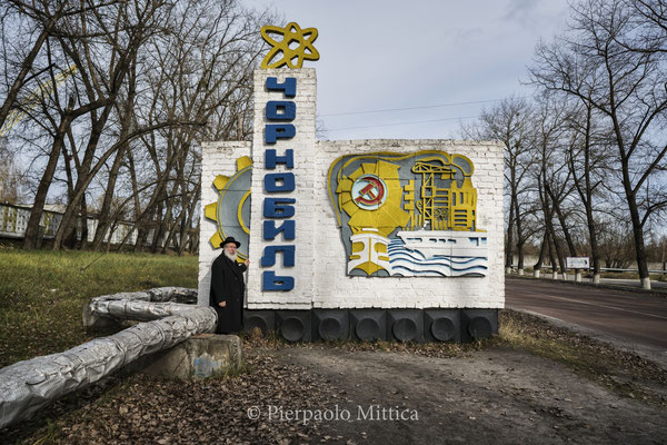 Yitz Twersky in front of the monument of Chernobyl entrance