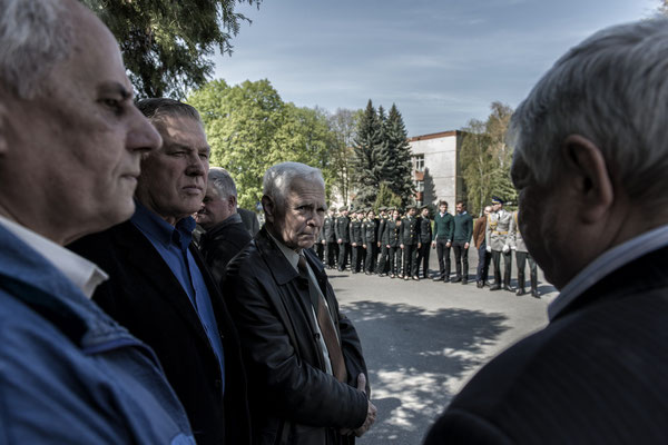 Former liquidators awaiting the delivery of medals in memory of the Chernobyl accident. Main square of the city of Chernobyl.