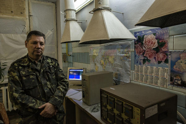 A lab technician showing the instrumentation to analyze the contamination. Scientific laboratories of the city of Chernobyl.