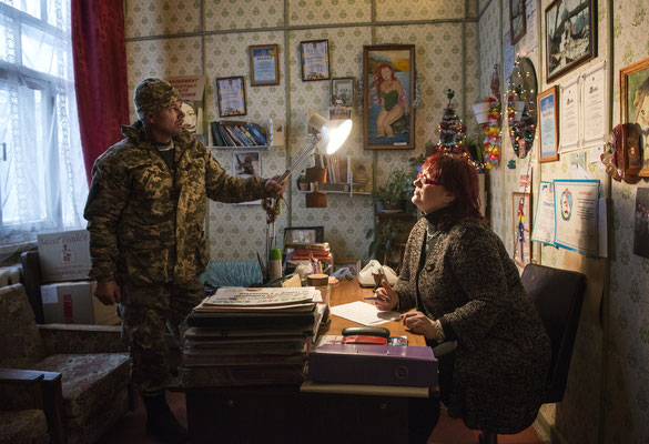 Tamara, the director of the House of Culture in Chernobyl and a keen opera singer, meets in her office with Serhiy to finalize the program, which includes shows and cultural events.