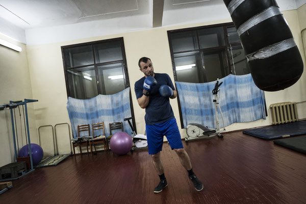 A man trains at the gym in Chernobyl. Many come here after work in order to stay in shape.
