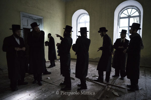 Jews inside the abandoned Chernobyl Synagogue.