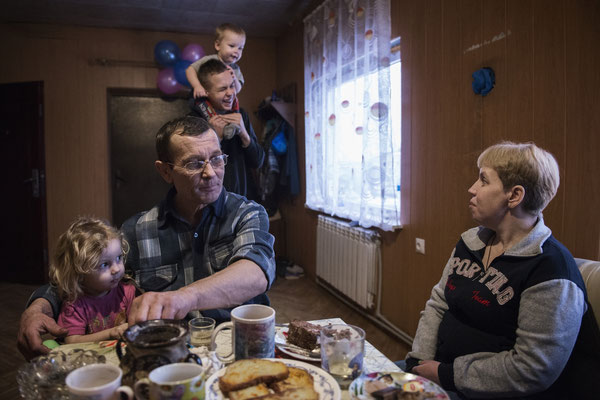 Victor with his family at home in the contaminated village of Kovalinka, situated just 5 kilometers from the border of the Chernobyl Exclusion Zone.