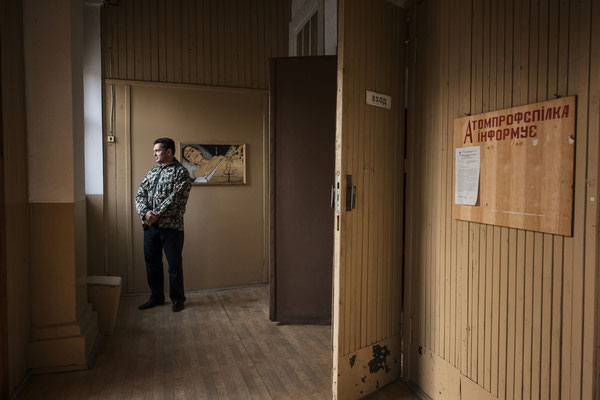 The house of culture in Chernobyl town. An audience member waits for the beginning of a theatre show