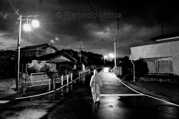 "Animal Activist in search of abandoned animals Odaka city, Fukushima ""No-Go Zone"", Japan."