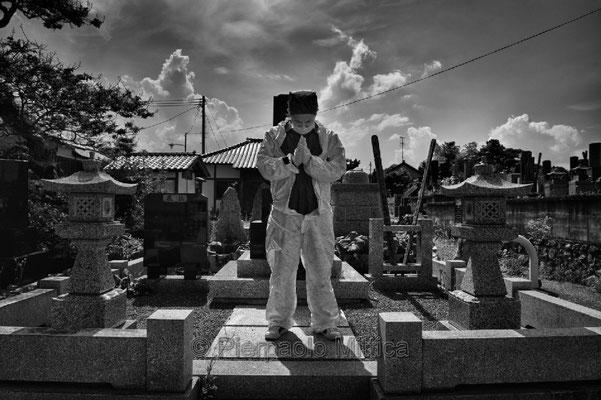 "Mister Matsumoto, Yakuza member and Tepco contractor is praying on his family grave, Fukushima ""No-Go Zone"", Japan."