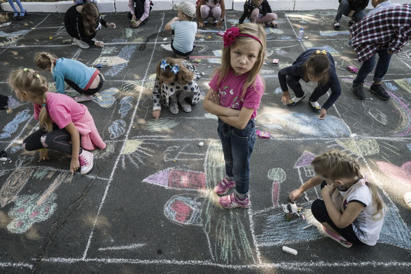 Children playing in the main square of Ivankiv during the local fair