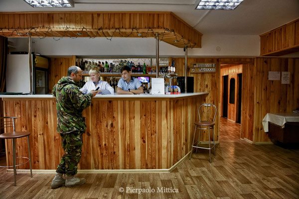 Yevgen Goncharenko in a work break in the bar inside the hotel, Chernobyl city, the exclusion zone