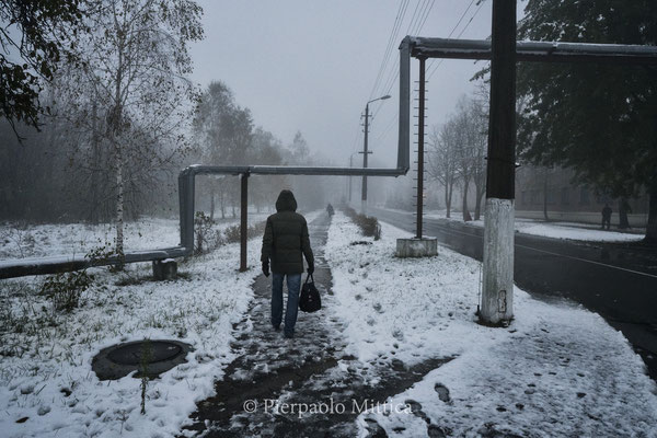 A worker while going home in Chernobyl town. Today in Chernobyl town 4000 workers live