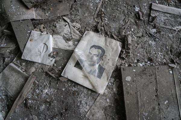 A school book lies on the floor in an abandoned school in Ochamchire.