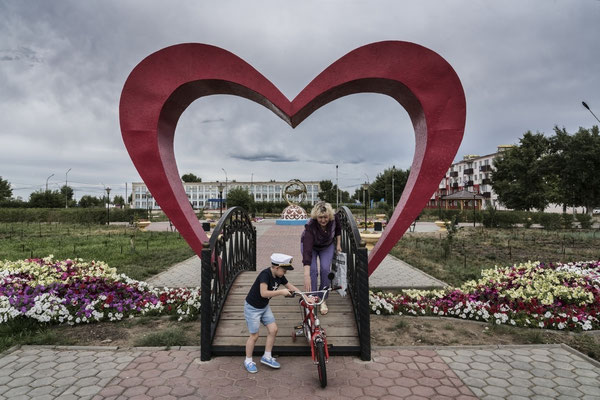 A boy with his mother in the main square of Kurchatov City.