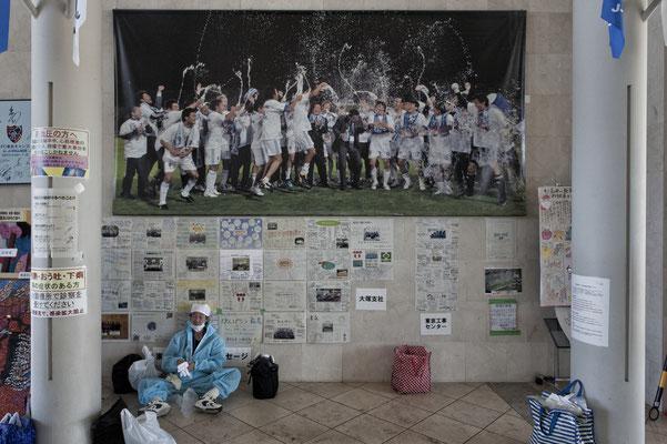 "Worker preparing to go to work, J village, the Tepco headquarter, Fukushima ""No-Go Zone"", Japan."