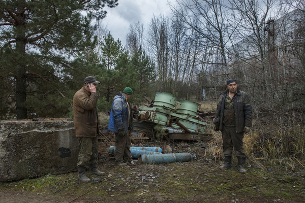Workers in search of radioactive scrap metal to be recycled. Chernobyl Exclusion Zone.